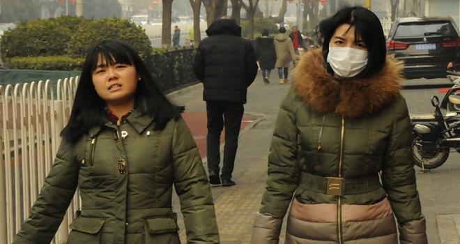 Pekin'de halka sokağa çıkmama uyarısı